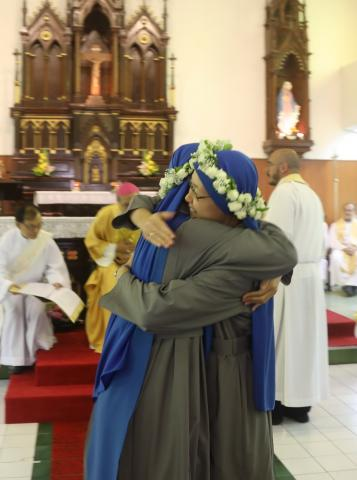 the two newly professed embraced each other
