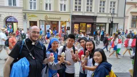 Pilgrims enjoying ice-cream of Poland