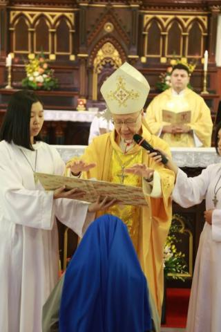 Receiving solemn blessings from His Eminence John Cardinal Tong Hon, Bishop of Hong Kong