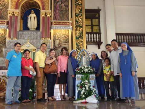 The newly professed sisters with their families
