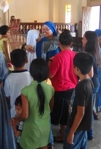 Sister greeting the Novice (2)