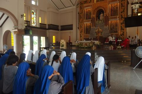 sisters praying for the novices