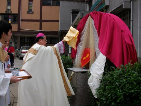 Installation of the memorial plaque by Bishop Joseph Li