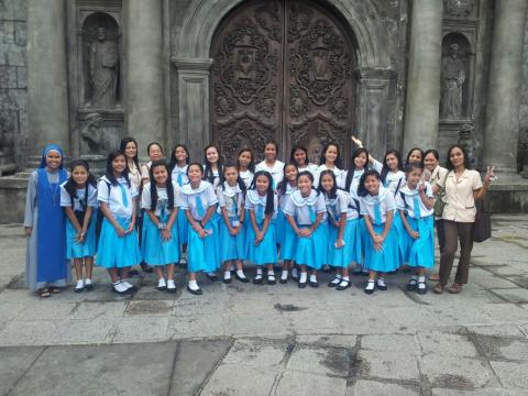 home school students outside the church
