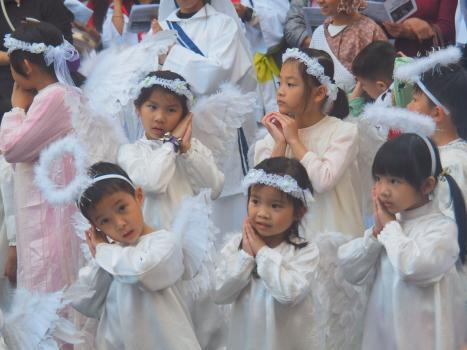 Children dressing as little angels at carolling